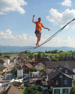 When you see a hovering person while looking out of the window, then you know it's time for a HIGHLINE SHOW!! Tijmen VD is warming up on this 55m @slacktivity pinkTube to amaze the spectators tomorrow :) . . #highline #highlineshow #slacklife #showtime #slackline #tightrope #balance #stunningview